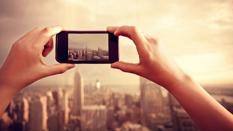 Instagram to run ads as user base tops 150 million monthly users