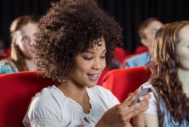 America's biggest cinema chain wants to let people use their smartphones during movies