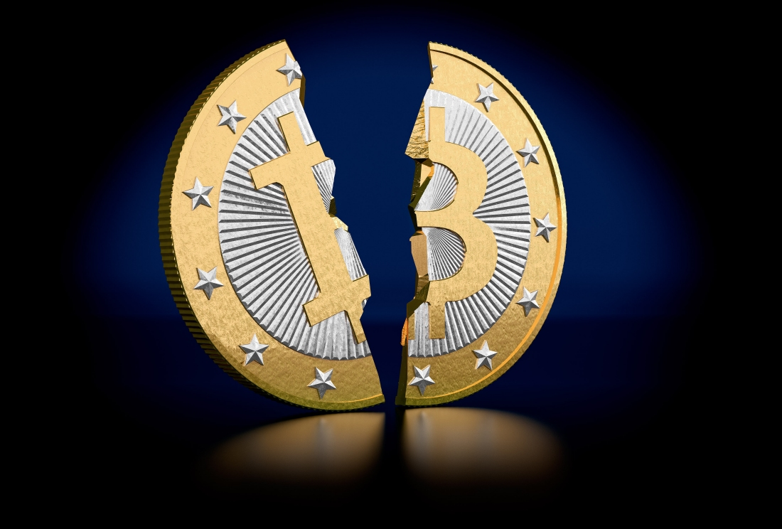 Bitcoin mining rewards cut in half to curb inflation