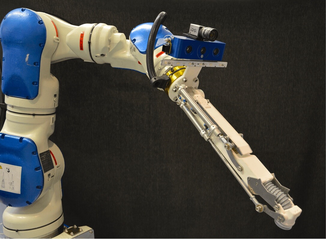 Suction cups and deep learning AI help robot arm win