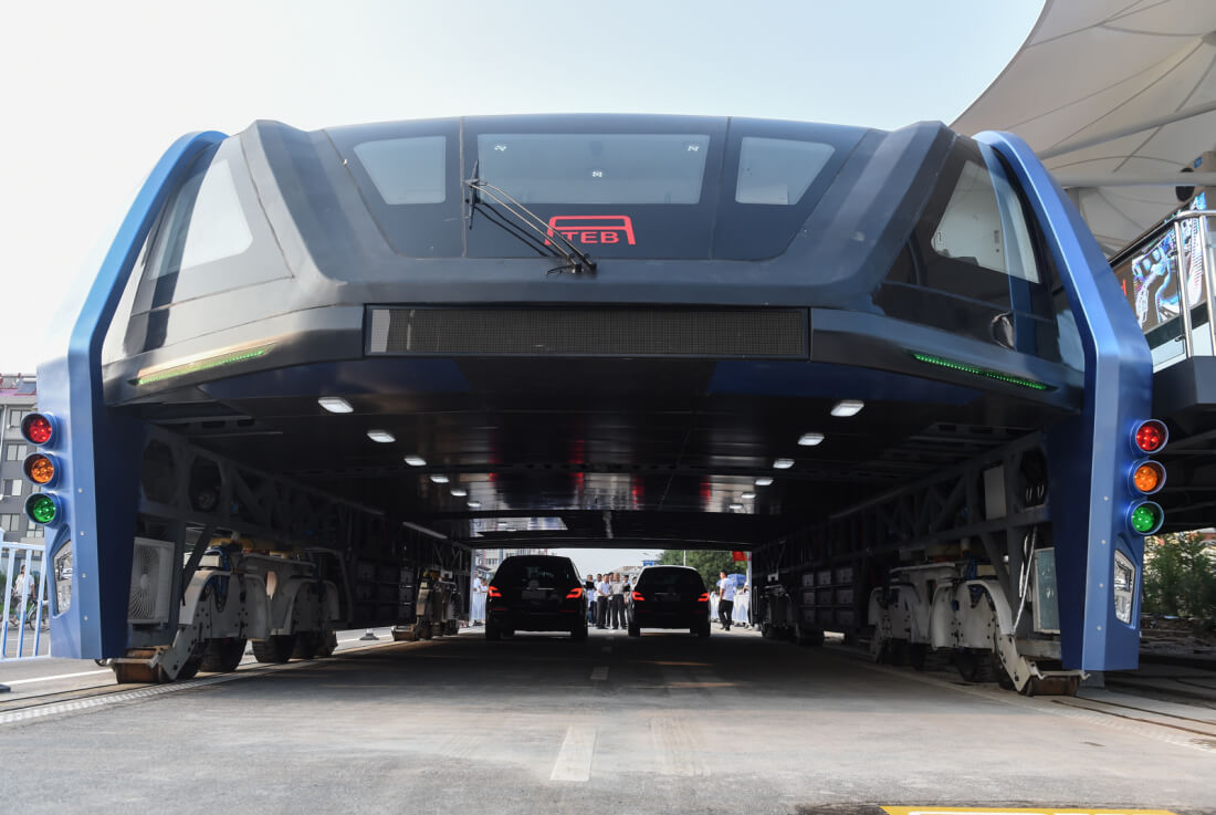 China's straddling bus now lies abandoned in the middle of the road