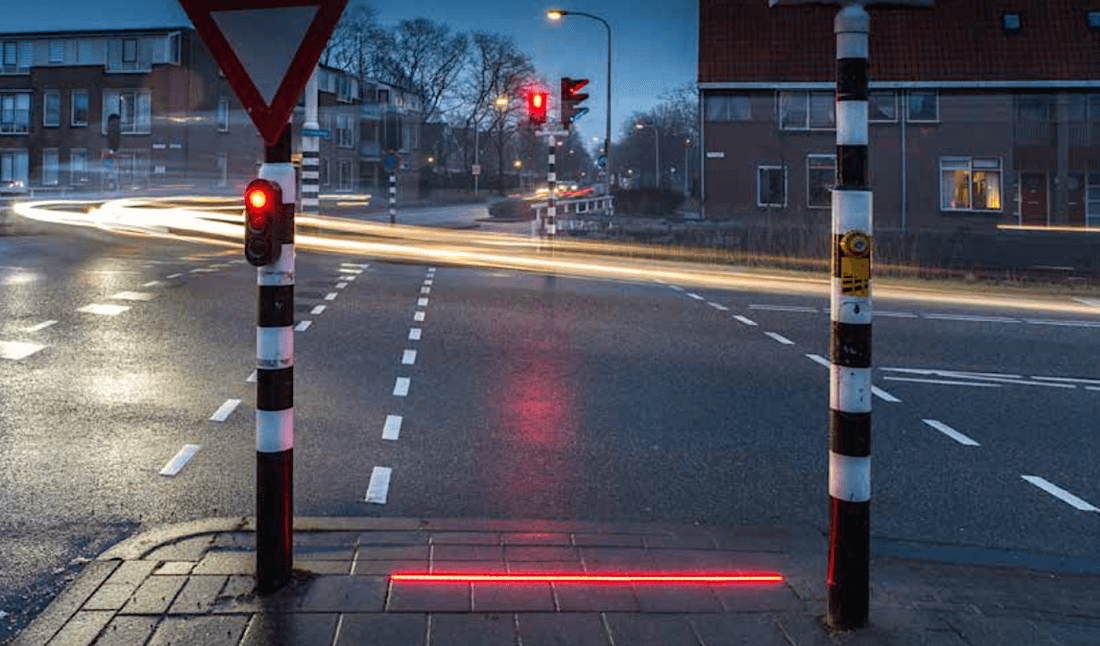 Sidewalk traffic lights designed for smartphone addicts appear in another location; this time they're bigger and brighter