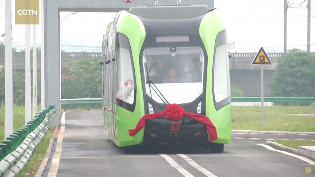 China unveils electric road train that runs on painted tracks