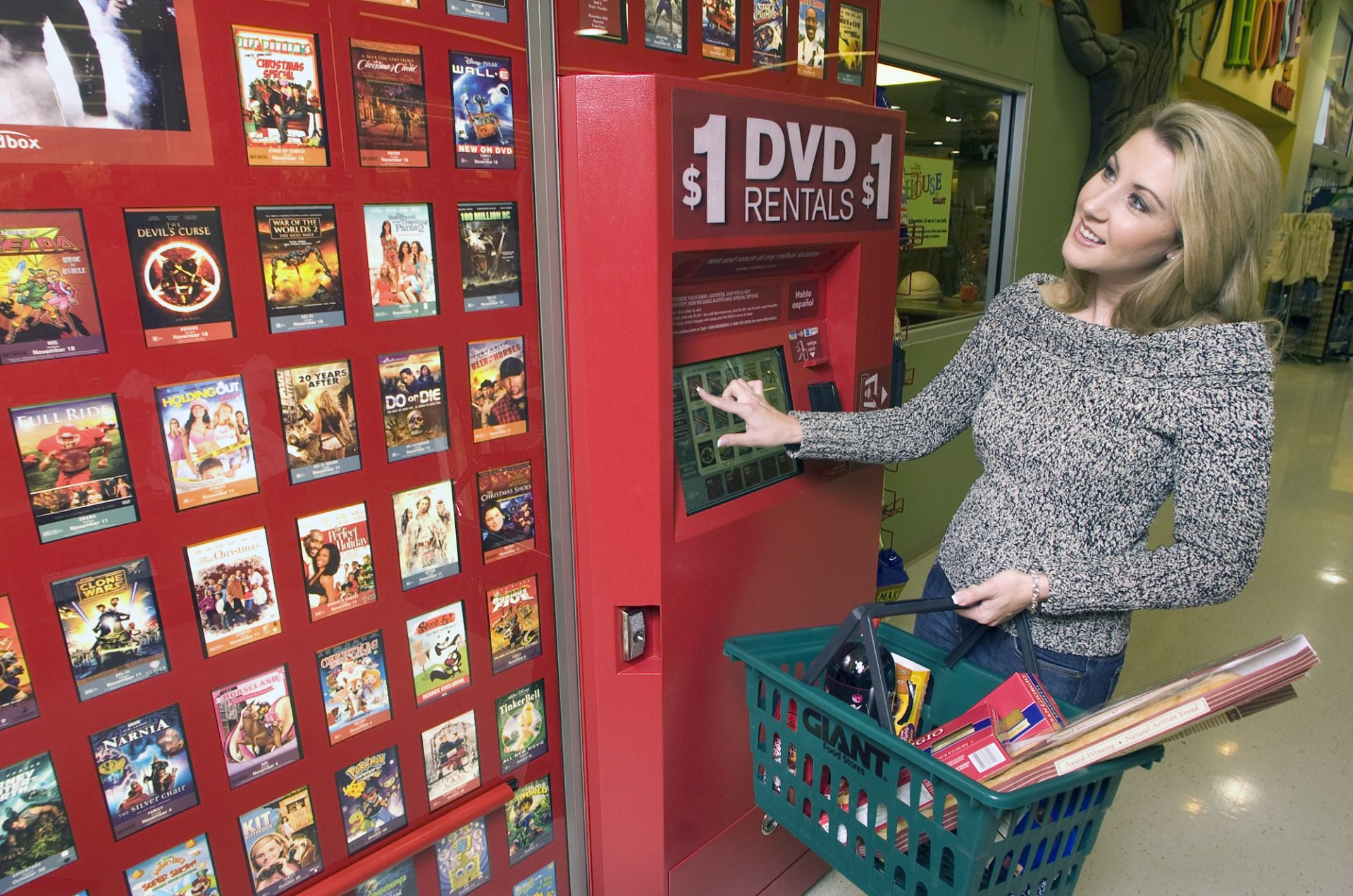 disney sues redbox over its sale of digital download codes