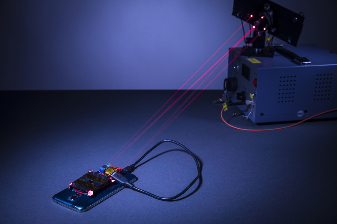 Prototype laser system can charge a smartphone from across the room