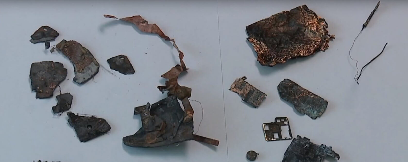 Woman says her Samsung phone exploded, started fire that destroyed car