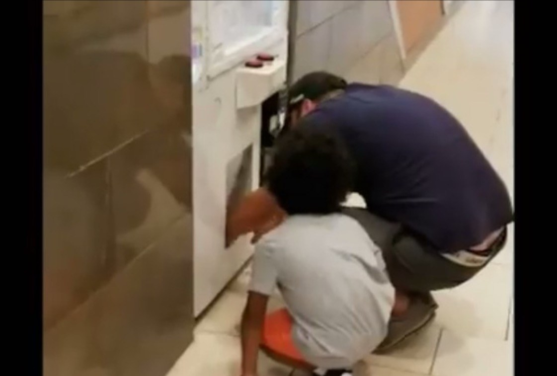 Man filmed forcing child to climb inside game machine to steal prizes
