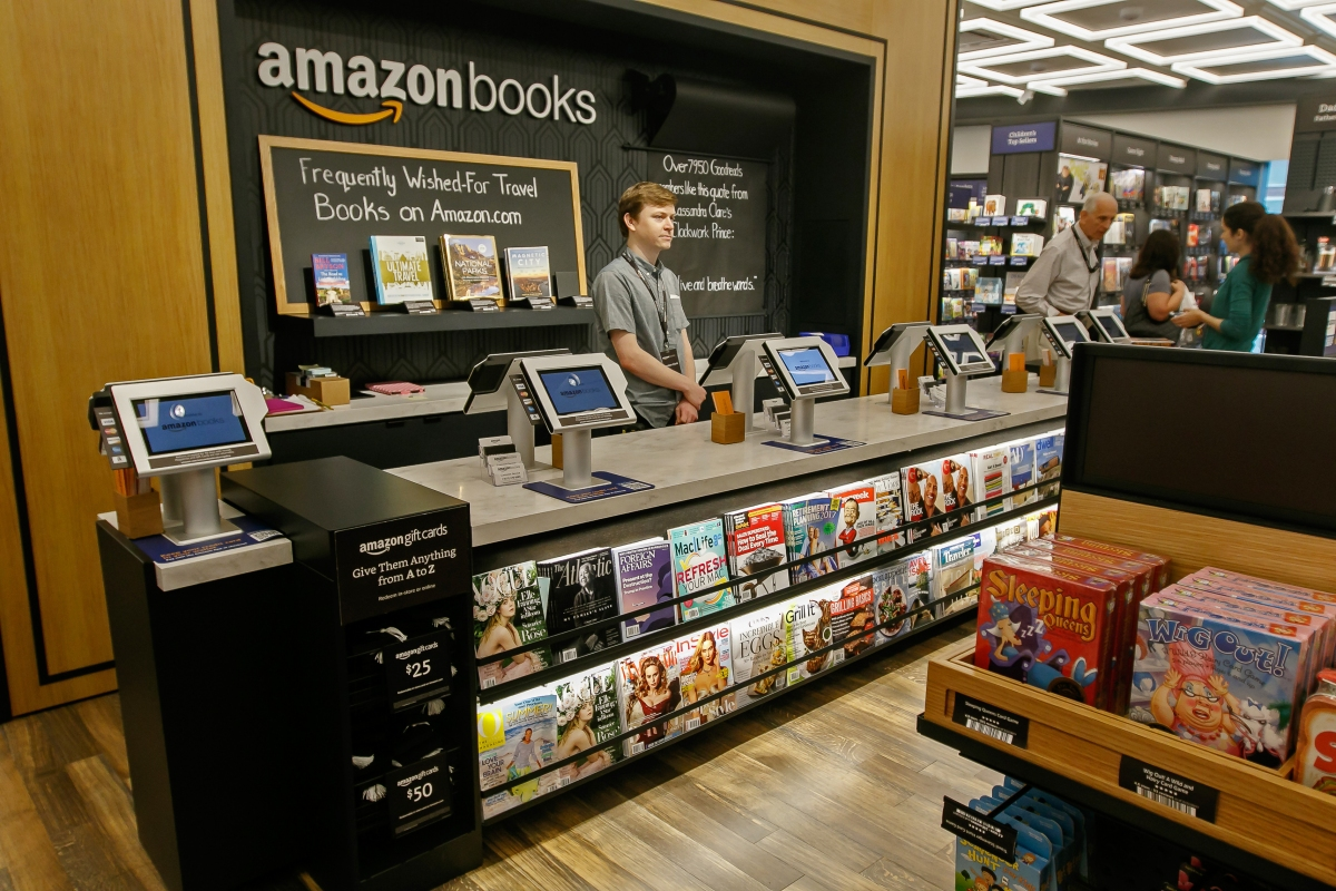 Amazon CEO Jeff Bezos challenges top retail rivals to increase their minimum wages