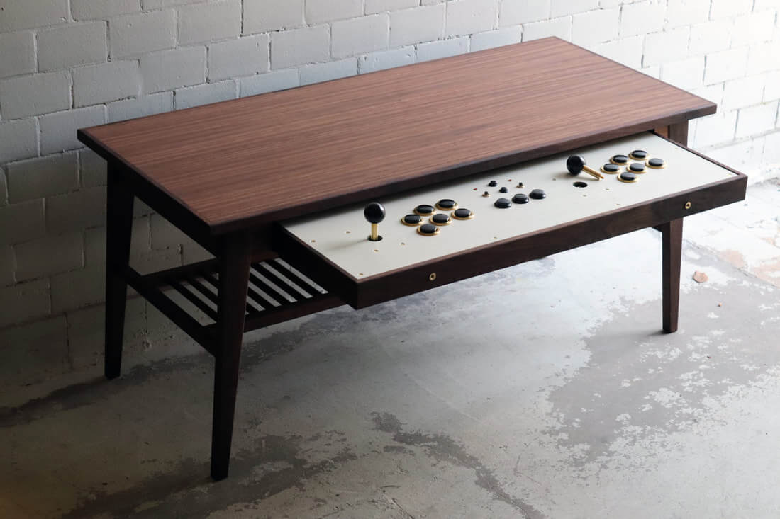 This unassuming coffee table transforms into an arcade machine