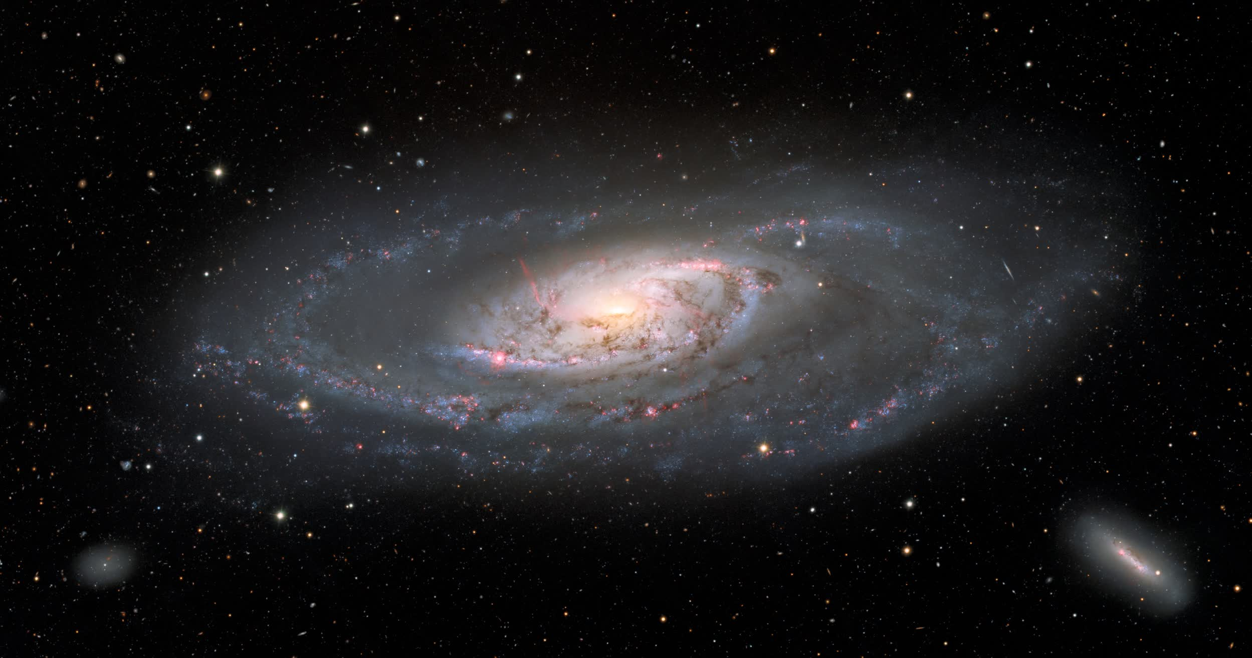 Striking image highlights the entirety of galaxy Messier 106