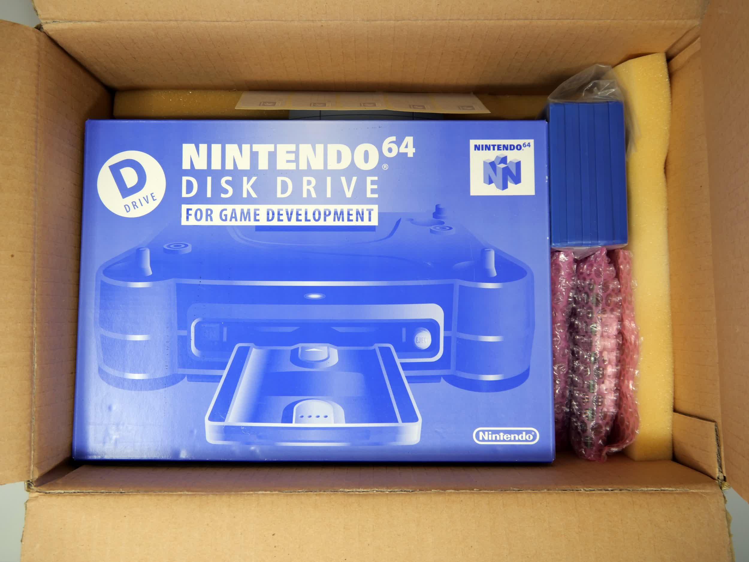 Rare, never-opened Nintendo 64 Disk Drive dev kit gets opened for the first time