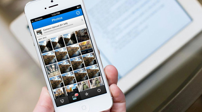 Dropbox temporarily suspends auto-upload feature on iOS, says iOS 8
